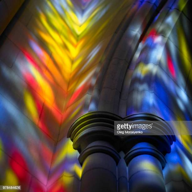 colorful reflections of stained glass murals - stained glass stock photos and pictures
