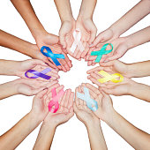colorful ribbons, cancer awareness, World cancer day background. many ribbons on hands isolated on white