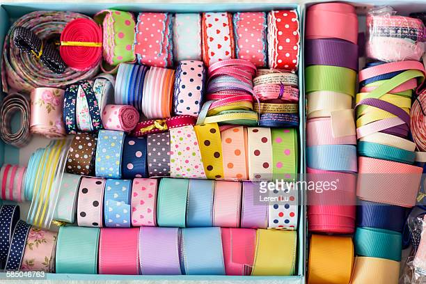 colorful ribbons in a box - ribbon sewing item stock pictures, royalty-free photos & images