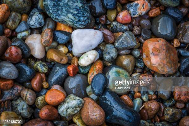 colorful rocks on a beach - shallow stock pictures, royalty-free photos & images