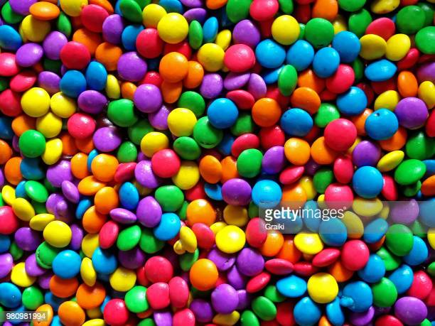 colorful round chocolates - letter m stock pictures, royalty-free photos & images