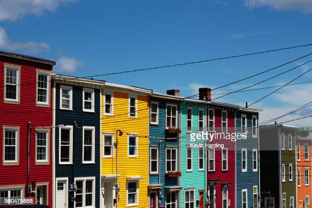 colorful row houses of newfoundland, st. johns, newfoundland and labrador, canada - st. john's newfoundland stock photos and pictures