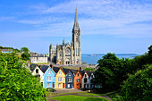 Colorful row houses with cathedral in background, Cobh, County Cork, Ireland