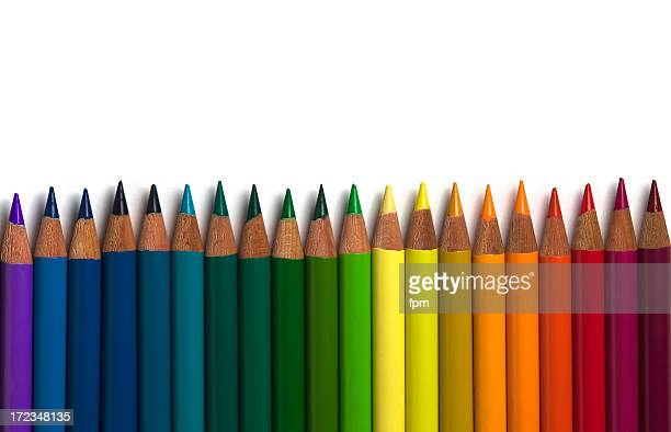 Colorful row of sharpened pencil crayons