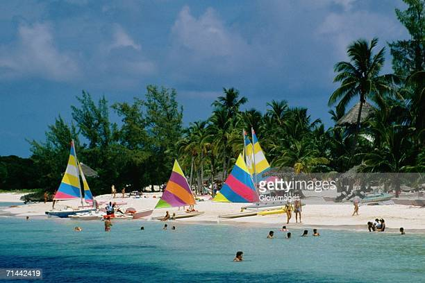 colorful sails on a beach, treasure island, abaco, bahamas - abaco islands stock pictures, royalty-free photos & images