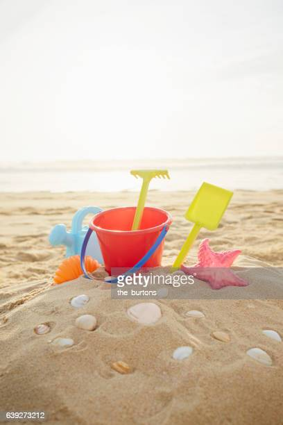 Colorful sand toys on the beach