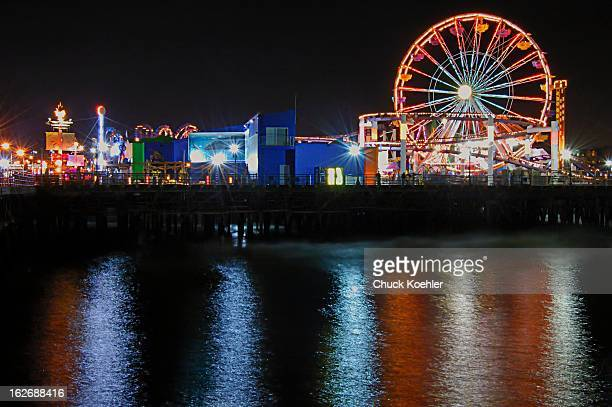 Colorful Santa Monica Pier Amusement Park at night from across the water. Rides and reflections make for an image that is full of color and life.