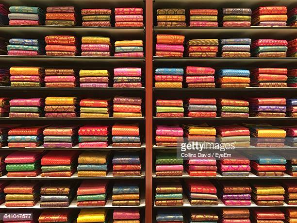 Colorful Saris In Shelves For Sale At Store