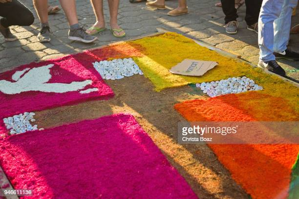 colorful sawdust carpets during holy week - easter cross stock pictures, royalty-free photos & images