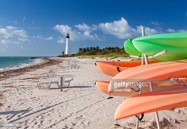 Colorful sea kayaks on beach Cape Florida Lighthouse in Bill Baggs State Park in Key Biscayne, Florida, USA