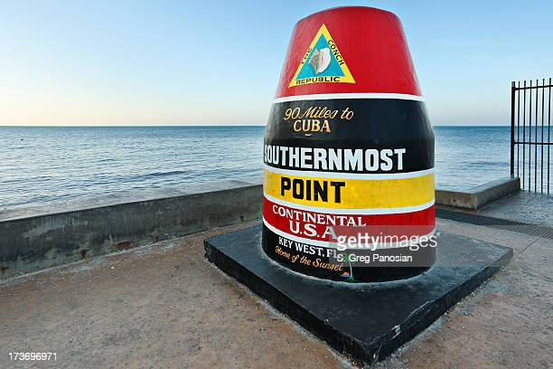 colorful seaside key west landmark marks southern tip of usa - key west stock photos and pictures