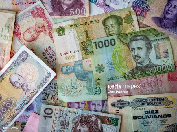 colorful selection of foreign fiat bank notes from around the world - 金融政策 ストックフォトと画像