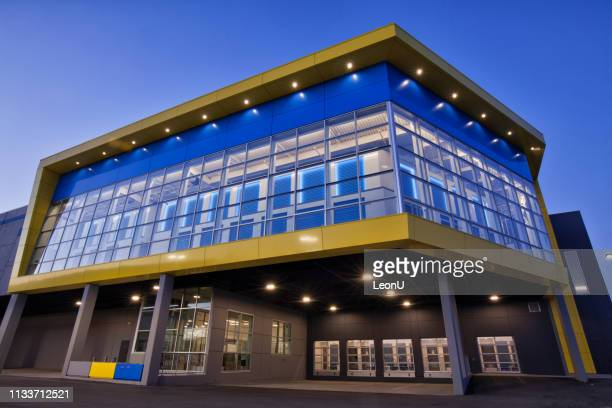 a colorful self-storage building in blue hour, vancouver, canada - self storage stock pictures, royalty-free photos & images