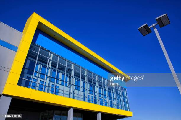 a colorful self-storage building in sunlight, vancouver, canada - self storage stock pictures, royalty-free photos & images