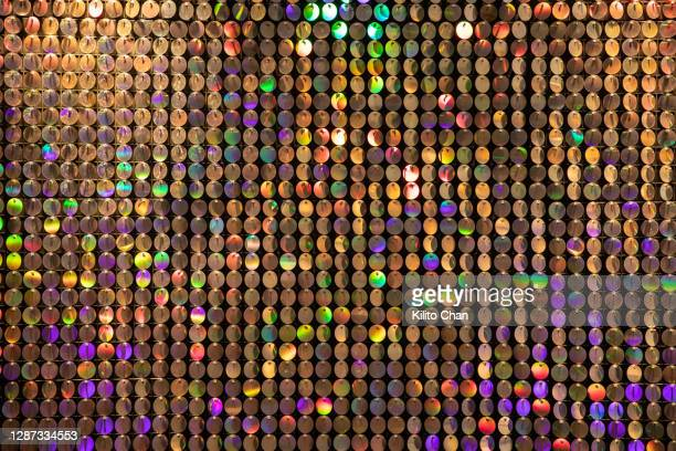 colorful sequins reflection - sequin stock pictures, royalty-free photos & images