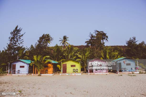 Colorful shacks on the side of a beach in Goa