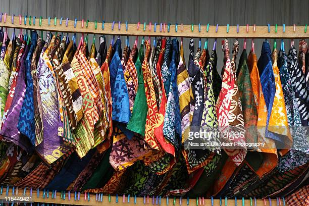 colorful shirts at market in accra, ghana - ghana stock pictures, royalty-free photos & images