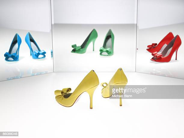 Colorful shoes reflected in mirror