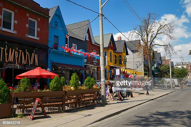 Colorful shops and buildings on Kensington Avenue Market in Toronto