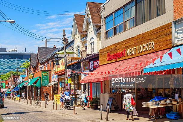 colorful shops at kensington market in toronto ontario canada - toronto stock pictures, royalty-free photos & images