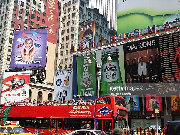 colorful signs and tourist at times square, new york, ny, usa - double decker bus stock pictures, royalty-free photos & images