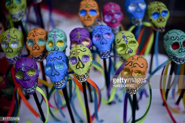 Colorful skull figures are displayed for sale during Holy Week celebrations in Mexico City on March 26 2016 For many years Mexicans have made...