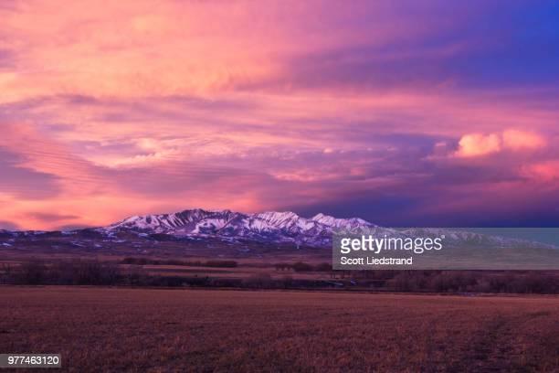 colorful sky over snowy mountains, bozeman, gallatin, montana, usa - bozeman stock pictures, royalty-free photos & images