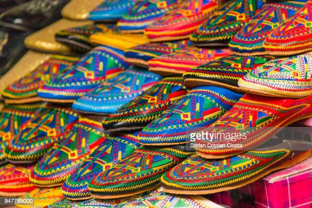 colorful slippers (babouches) for sale in morocco - agadir photos et images de collection
