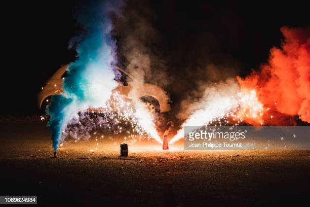 colorful smoke with french flag colors and sparkles in a city street at night - burning stock pictures, royalty-free photos & images