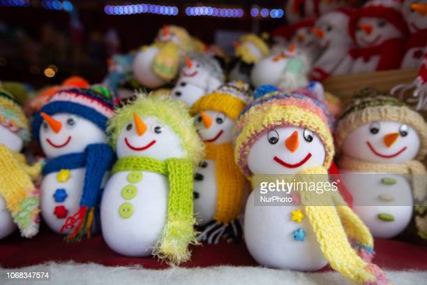 Colorful Snowmen made of cotton The Christmas Market at the Chinesischer Turm in the Englischer Garten is opened until the 24th of December