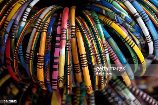 colorful souvenir bracelets, banjul, gambia - banjul stock pictures, royalty-free photos & images