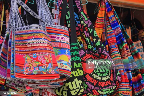colorful souvenirs for sale in the cruise port area of oranjestad, aruba - oranjestad stockfoto's en -beelden