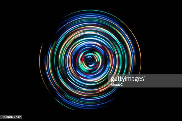 colorful spinning light trails - circle stock pictures, royalty-free photos & images