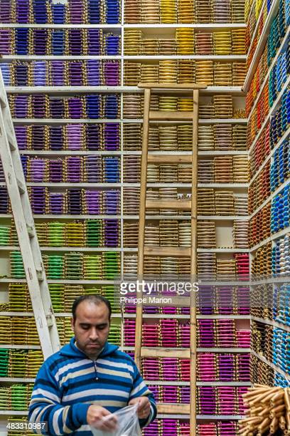 CONTENT] Colorful spools of thread for sale in the old souk in the ancient medina of Fez Morocco