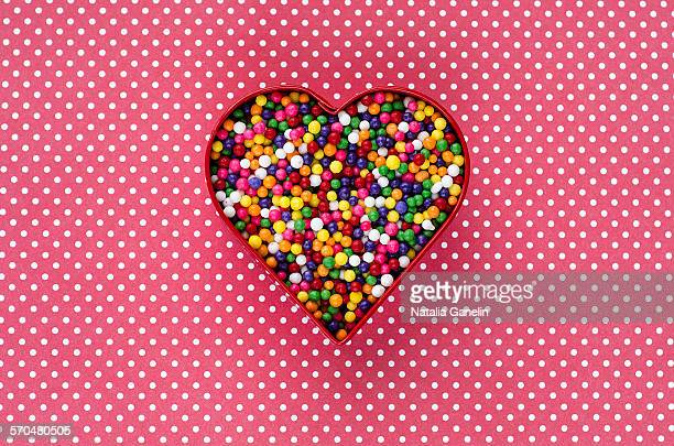Colorful sprinkles in heart shape cookie cutter
