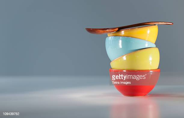 Colorful stacked bowls with spoon