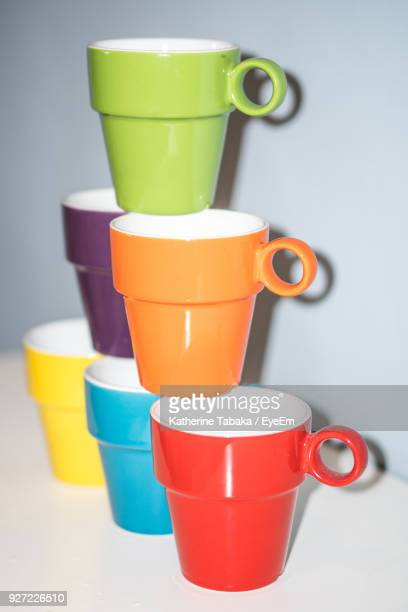 Colorful Stacked Mugs On Table