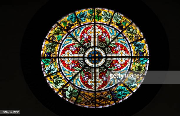 colorful stained glasses, dome church, historical center of riga. latvia - katholizismus stock-fotos und bilder