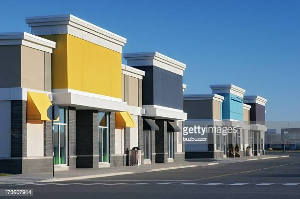 colorful store building exteriors - facade stock pictures, royalty-free photos & images