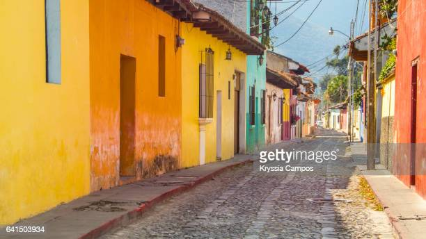 colorful street in old colonial city of antigua, guatemala - guatemala stock pictures, royalty-free photos & images