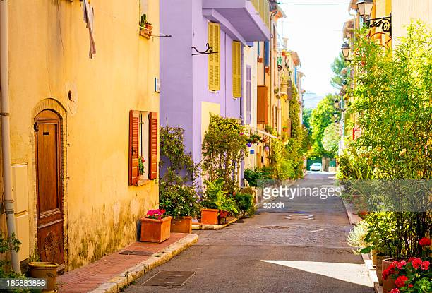 colorful street in town in provence, france - france stock pictures, royalty-free photos & images