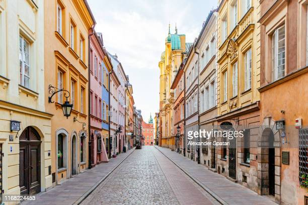 colorful street in warsaw old town, poland - pedestrian zone stock pictures, royalty-free photos & images