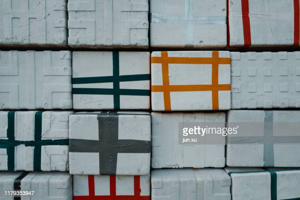 colorful stripes on stacked white foam boxes - white stripes stock pictures, royalty-free photos & images