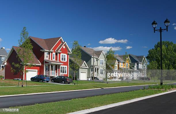 colorful suburban homes - residential district stock pictures, royalty-free photos & images