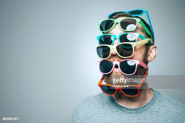 colorful sunglasses portrait - group of objects stock photos and pictures