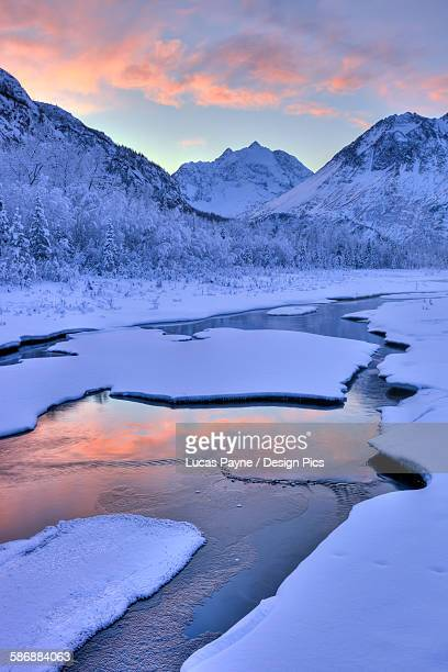 colorful sunrise over a stream at the eagle river nature center in chugach state park, southcentral alaska, winter, hdr - chugach state park stock pictures, royalty-free photos & images