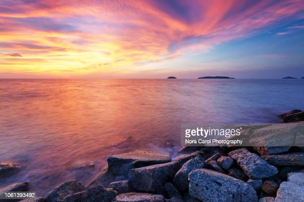 colorful sunset background - kota kinabalu stock pictures, royalty-free photos & images