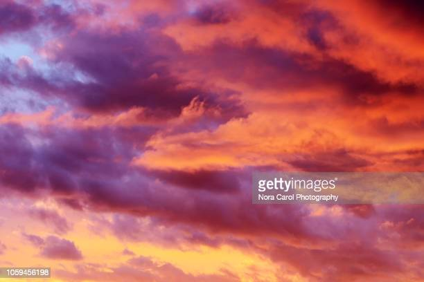 colorful sunset clouds background - colorful sunset stock photos and pictures