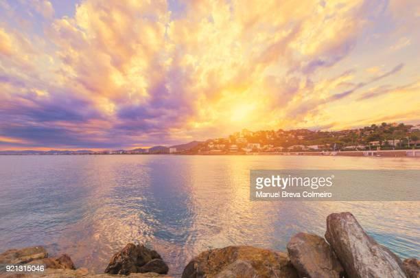 colorful sunset in benicassim - castellon de la plana stock photos and pictures