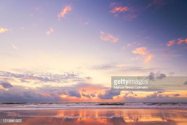 colorful sunset in cadiz - cádiz fotografías e imágenes de stock